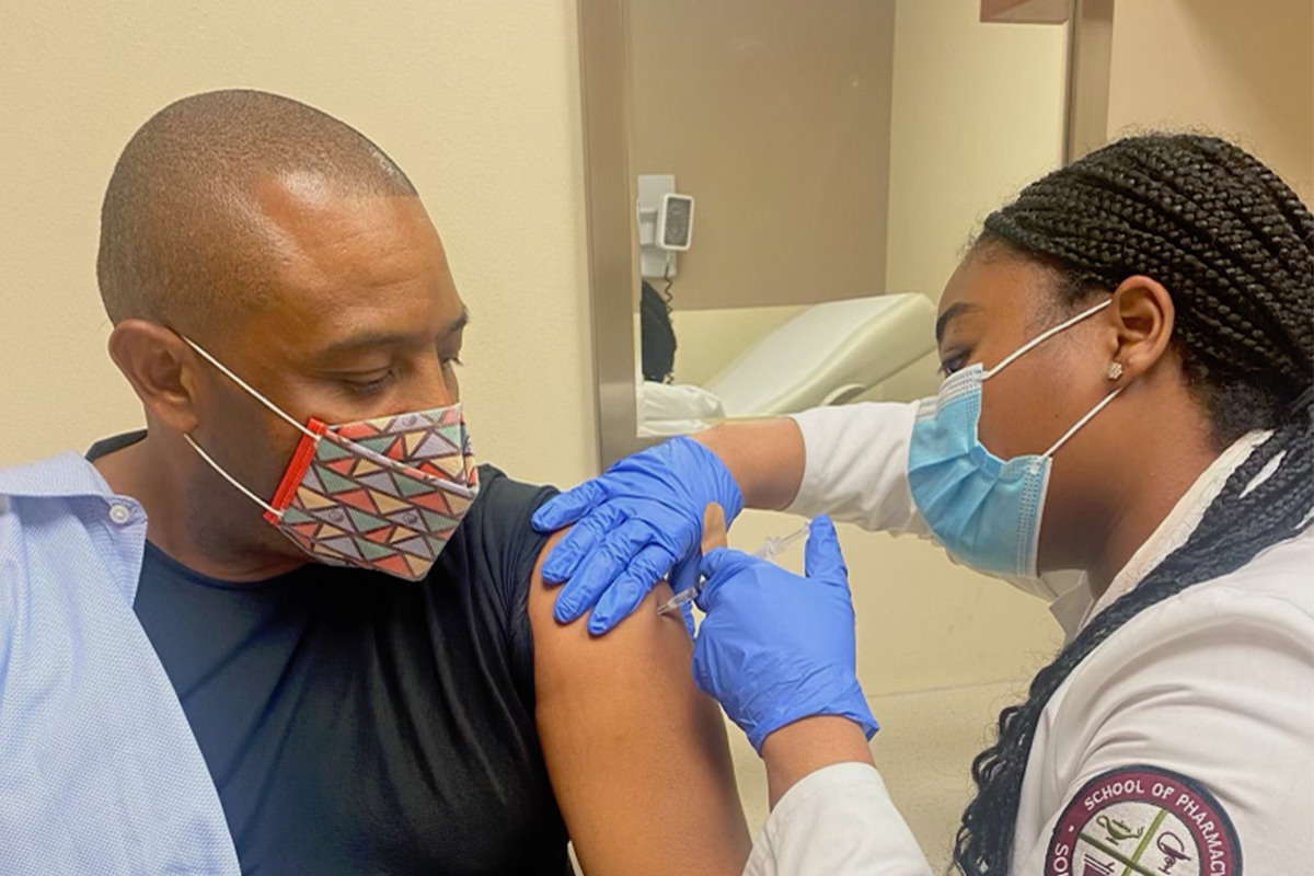 Kevin Woods receives a COVID-19 vaccine